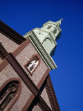 Statue and Steeple on Church of Transfiguration in Chinatown  New York City  New York  USA