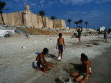 Children Playing on Beach in Front of Restored Fort Ribat  Monastir  Tunisia