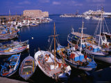 Fishing Boats in Harbour with Venetian Fortress Herakleion in Distance  Greece