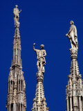 Stone Statues Stand Atop the Spires of the Duomo  Milan  Lombardy  Italy