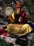 Monk Performing Ritual in Chingdrol Chiling Park  Using Hand-Held Drum and Bell  Lhasa  China
