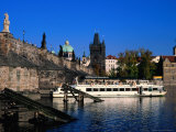 Passenger Ferry Cruising Up Vltava River Near Charles Bridge  Prague  Czech Republic