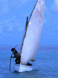 A Fisherman Using a Piece of Wood to Help Propel His Sail-Boat  Rodrigues Island  Africa