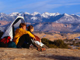 Couple Camping at Slickrock with Snow-Capped Peaks in the Background  Utah  USA