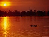Fisherman Heading Out for Night Fishing Under Mekong River Sunset  Si Phan Don  Laos