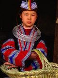 Girl in Traditional Dress Carrying Basket  Anshun  China