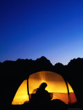 Camper Reading by Lantern in Tent at Dusk  Yosemite National Park  USA