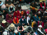Worshippers Sitting Outside Main Assembly Hall at Sera Monastery  Lhasa  Tibet