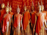 Statues Draped in Saffron in the Royal Funerary Carriage House at Wat Xieng Thong  Laos