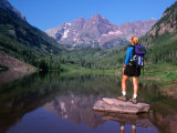 Hiker Stands on a Rockoverlooking Maroon Bells  Aspen  Colorado  USA
