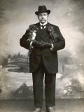 French Man in a Black Suit with a Pekingese Dog Under Each Arm