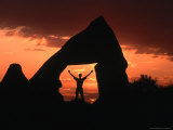 Person Standing in Rock Cut at Sunset  Cappadocia  Turkey