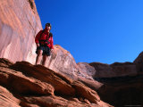 Hiker Standing on a Ledge at Lake Powell  Utah  USA