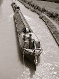 A Canal Boat Transporting Cargo Along the The Narrow Waterway Near Kings Langley  Hertfordshire