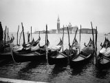 Gondolas and Gondoliers on a Rainy Day in Venice Italy  June 1965