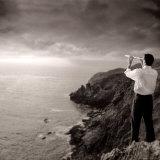 Man Looking Through Telescope at Horizon