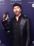 The Ivor Novello Music Awards  the Edge from U2 is Best Song Musically and Lyrically  May 2002