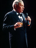 Frank Sinatra Sings in Concert with Drink in Hand