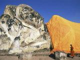 Thailand  Ayutthaya Historical Park  Wat Lokaya Sutha  Monk Preying at Giant Reclining Buddha