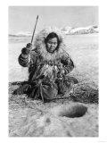 Eskimo Woman Fishing through Ice in Alaska Photograph - Alaska