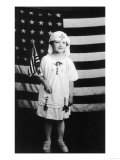 Little Girl in Nurses Outfit Holding US Flag