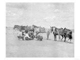 Cowboys Observe a Map on the Ground Photograph - Texas