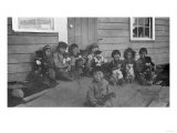 Eskimo Children and Puppies Photograph - Alaska