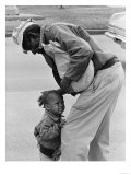 African American Man Comforts Crying Child Photograph