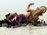 Devotees Immerse a Giant Clay Idol of Hindu Elephant-Headed God Ganesh into the Arabian Sea  Bombay