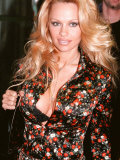 Pamela Anderson Arriving at London Heathrow Airport  February 2000