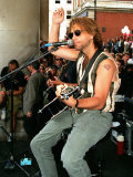 Pop Star Jon Bon Jovi Busking in Covent Garden to the Crowds Playing Guitar and Singing Into Mike