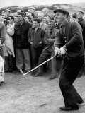 Arnold Palmer Takes a Swing as Crowd Look on Golf