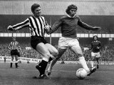 Ollie Burton of Newcastle United Tries to Tackle Alan Ball of Everton During Their Match