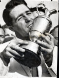 Golfer Gary Player Celebrates Winning the Open Golf Championship by Kissing Trophy