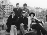 Rolling Stones Sitting on Bench in Park