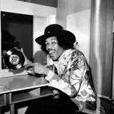 American Musician Jimi Hendrix in Dressing Room Holding a Copy of Single  Earing a Black Hat