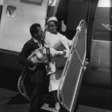 Mike Todd with Elizabeth Taylor Flying to Nice in 1957