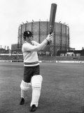 Andy Williams  Swinging His Bat in the Shadow of the Oval's Famous Gasometer