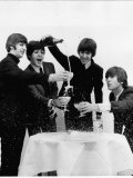 Beatles Sitting Round a Table with Glasses of Champagne