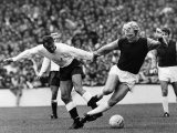 Bobby Moore of West Ham is Tripped by Tottenham Hotspur Forward Jimmy Greaves
