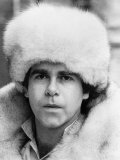 Elton John Pop Singer Wearing a White Fur Hat and Coat
