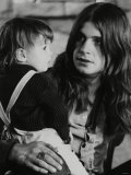 Black Sabbath Lead Singer Ozzy Osbourne Holding a Child