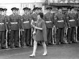 Soldiers Smile as a Lady in Mine Dress and Coat Walks Past Parade Line Up Investiture Rehearsals