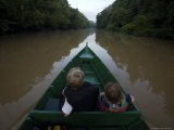 Kids Ride in a Boat Up the Menangul River  Borneo