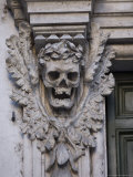 Stone Carving of a Laurel Leaf Encircled Human Skull on a Pilaster