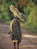Woman in Local Dress Carries a Bundle of Sticks on Her Head