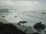 Waves Wash Ashore on a Fog-Shrouded San Simeon Beach