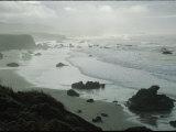 Waves Wash Ashore on a Fog-Shrouded San Simeon Beach