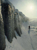 Skier on a Frozen Fjord Beneath Ice Cliffs of Nordenskjold Glacier