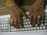 Woman's Hands on a Computer Keyboard Decorated with Henna